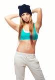 Beautiful smiling hip hop dancer posing in studio Royalty Free Stock Images