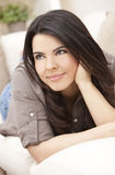 Beautiful Smiling Hispanic Woman on Sofa Relaxing Royalty Free Stock Photo