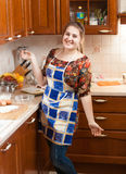 Beautiful smiling housewife in apron Stock Photo