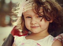 Beautiful smiling kid girl face with curly hair Stock Photography
