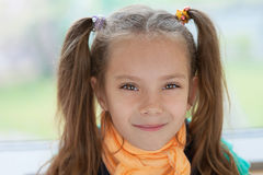 Beautiful smiling little girl. Portrait of beautiful smiling little girl close-up Stock Photos