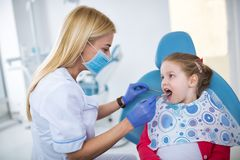 Beautiful smiling little girl in dental office. Waiting for dental treatment Stock Photo