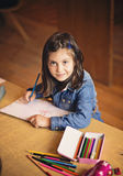 Beautiful smiling little girl drawing Stock Images