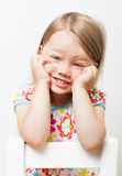 Beautiful smiling little girl. Beautiful funny smiling little girl on light gray background royalty free stock photo