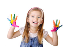 Beautiful smiling little girl with hands in the paint isolated Royalty Free Stock Images