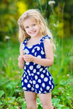 Beautiful smiling little girl with long blond curly hair Royalty Free Stock Images