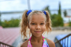 Beautiful smiling little girl. With pigtails closeup Stock Images