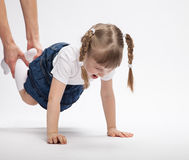 Beautiful smiling little girl playing with her parent. White background Stock Photos