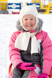 Beautiful smiling little girl in snow Royalty Free Stock Photography
