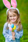 Beautiful smiling little girl wearing pink rabbit or bunny ears. Beautiful smiling little girl with long blond hair wearing pink rabbit or bunny ears and blue Stock Images