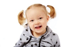 Beautiful smiling little girl. White background, Caucasian, blond hair Royalty Free Stock Images