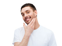 Beautiful smiling man touching his face Royalty Free Stock Photo