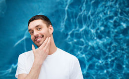Beautiful smiling man touching his face Royalty Free Stock Photos