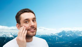 Beautiful smiling man touching his face Royalty Free Stock Photography