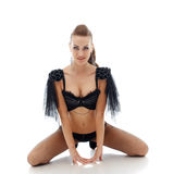 Beautiful smiling model posing in erotic costume Royalty Free Stock Image