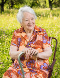 Beautiful smiling old woman sitting in the chair Royalty Free Stock Photo