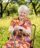 Beautiful smiling old woman sitting in the chair Stock Photo