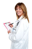 Beautiful smiling physician writing prescription Stock Photo