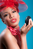 Beautiful smiling pinup girl checking makeup Royalty Free Stock Photos