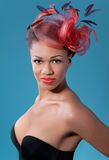 Beautiful smiling pinup girl wearing a hat Stock Images