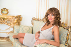 Beautiful smiling pregnant woman in an expensive interior Royalty Free Stock Image