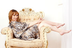 The beautiful smiling pregnant young woman in a seat Royalty Free Stock Photography