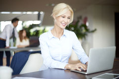 Beautiful smiling professional woman with laptop Stock Photos