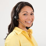 Beautiful smiling receptionist on the telephone Stock Photos