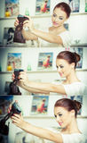 Beautiful, smiling red hair woman taking photos of herself with a camera. Fashionable attractive female taking a self portrait Stock Photography