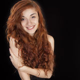 Beautiful smiling red haired girl Stock Photo