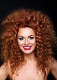 Beautiful smiling redhead woman Stock Image