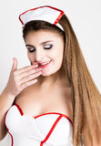 Beautiful smiling sexy nurse standing and wipes lipstick from lips Royalty Free Stock Photo