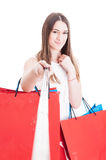 Beautiful smiling shopaholic doing shopping and taking a self po Royalty Free Stock Image