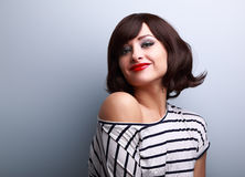 Beautiful smiling short hair woman looking happy on blue backgro. Und. CLoseup portrait Stock Photo