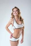 Beautiful smiling sportswoman posing in studio Stock Photography