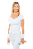 Beautiful smiling sportswoman wearing white sports clothes holdi Royalty Free Stock Photography