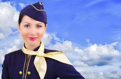 Beautiful smiling stewardess. On a background sky Stock Image