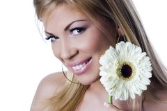 Beautiful smiling and stylish girl with white flower. On white background Royalty Free Stock Images