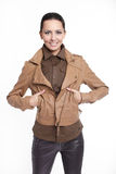 Beautiful smiling stylish woman in brown jacket Royalty Free Stock Photos