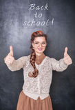 Beautiful smiling teacher showing thumbs up Royalty Free Stock Images