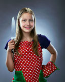 Beautiful smiling teen chef holding a knife Royalty Free Stock Photo