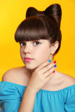 Beautiful smiling teen girl with bow hairstyle, makeup and colou Royalty Free Stock Image
