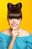 Beautiful smiling teen girl with bow hairstyle, makeup and colou Royalty Free Stock Photo