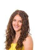 Beautiful smiling teen girl with long curled hair Stock Photo