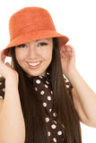 Beautiful smiling teen girl model adjusting orange hat Royalty Free Stock Photography