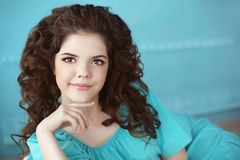 Beautiful smiling teen girl portrait, brunette with healthy curl Stock Photos