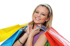 Beautiful smiling teen girl with shopping bags Royalty Free Stock Photos
