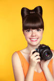 Beautiful smiling teen girl taking a photo. Pretty model is a pr Stock Photos
