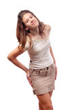 Beautiful smiling teenage girl in short skirt Stock Photo