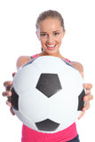 Beautiful smiling teenage girl with soccer ball Stock Image